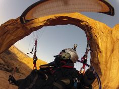 Flying Through the Arch - A paramotor pilot flies through the Corona Arch near Moab, Utah. This daring feat was captured with...