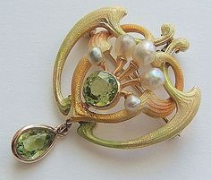 Early 20th Century Lavalier:  Peridot and Baroque pearls; 14 Karat yellow gold with green, yellow, gold and peach enamel.  | Riker Brothers