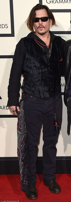 Going to seed? Johnny Depp showed up at the Grammys in jeans that had to be turned up at t...