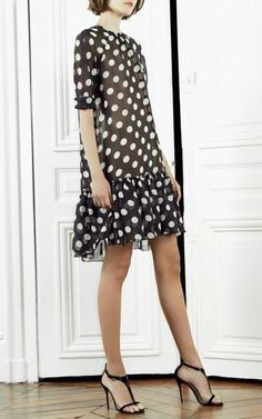 Shop this look on Lookastic:  http://lookastic.com/women/looks/black-and-white-polka-dot-shift-dress-black-leather-heeled-sandals/10509  — Black and White Polka Dot Shift Dress  — Black Leather Heeled Sandals