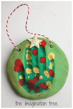 How to make some adorable Christmas tree ornaments from green sparkly salt dough, using little handprints!