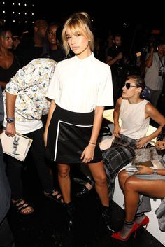 Hailey looked too cool at Public School in a white and black outfit, which included a printed leather skirt and booties.