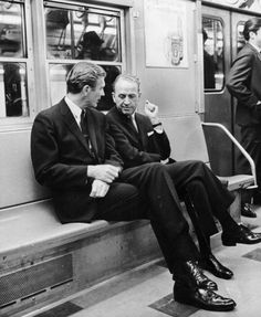 Mayor John Lindsay and city council president Frank O'Connor ride the subway back to City Hall after a news conference in support a transportation bond proposition on Nov. 6, 1967.