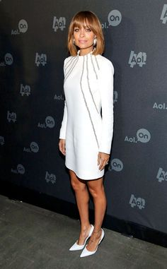 Nicole Richie from Celebs Wow in White The Fashion Star mentor attends the AOL Digital Content NewFront in New York wearing a head-to-toe Saint Laurent ensemble with vintage earrings.