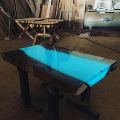 Glow Tables the light-dark quality of the table's smooth surface is achieved