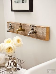 Rustic bathroom decor should look as if it has been handled by many people over a long period of time. This room-appropriate artwork features three vintage faucets that double as towel hooks when needed. # rustic upcycle home decor Rustic Bathroom Ideas Rustic Bathroom Decor, Rustic Bathrooms, Rustic Decor, Bathroom Ideas, Bathrooms Decor, Rustic Chic, Lowes Bathroom, Bathroom Rack, Rustic Crafts
