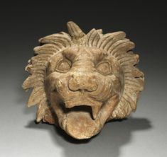 Lion's Head, 400s BC Greece, 5th Century BC.  Compare to the lion's heads on the giant bronze doors to the Nashville Parthenon.