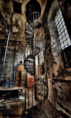 "An urban explorer never knows what awaits during infiltration of a crumbling building. This Victorian spiral staircase was captured at Maltings ""S"", an abandoned brewery in Lincolnshire, England. The photograph is titled Elegance Unravelling by  DigiTaL~NomAd."