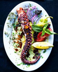 "Just incredible. Grilled Mediterranean Octopus seasoned smoked and seared to mouthwatering perfection above a raging Inferno of dried coconut shells and a blend hardwoods. Brilliant!  . PSA: Are you a BBQ Junkie? Love grilling like you love life? Click ""FOLLOW"" for a guilt & gluten-free diet of daily food & travel pornography. Share via @regrann or @repost app.  Blog: http://ift.tt/1vCV6pv  Courtesy: Saveur Magazine 