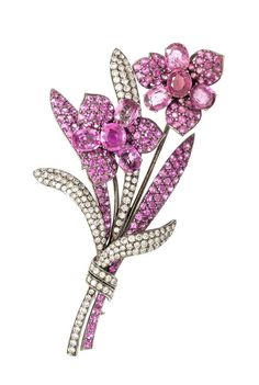 An 18 Karat White Gold, Pink Sapphire and Diamond En Tremblant Flower Brooch, Michael Youssoufian, containing eight oval mixed cut and numerous pave set round mixed cut pink sapphires, together with numerous pave set round brilliant cut diamonds weighing approximately 3.50 carats total within a black rhodium plated gold setting.