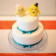 This couple decorated their venue in punchy shades and a bow-tied cake complete with baby chick toppers. Photo by Cassie's Camera.
