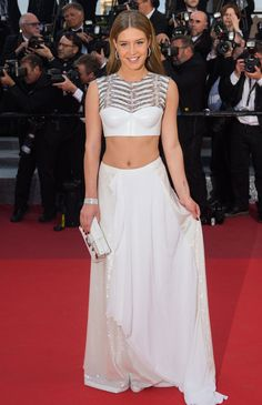 20 May Adele Exarchopoulos walked the red carpet in a fitted crop top and matching white maxi skirt.   - HarpersBAZAAR.co.uk