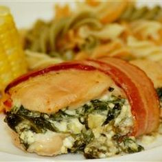 Spinach and Feta Cheese Stuffed Chicken Breasts, wrapped in bacon. Tangy and very filling! (allrecipes.com)