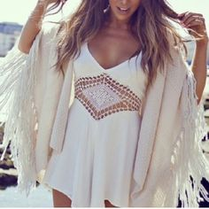 Boho Romper White Super cute oversized white romper. 34 inches from shoulder to bottom hem; 15 inches wide across the net laid flat. Will fit M or L. New! NWOT *Boho necklaces also for sale :) Complete your look today with the perfect accessory! Other