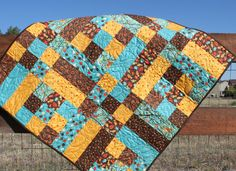 Love this quilt pattern!  Based on size it's 9 inch finished blocks.  To make a good sized baby quilt should do 5 x 5 squares instead.