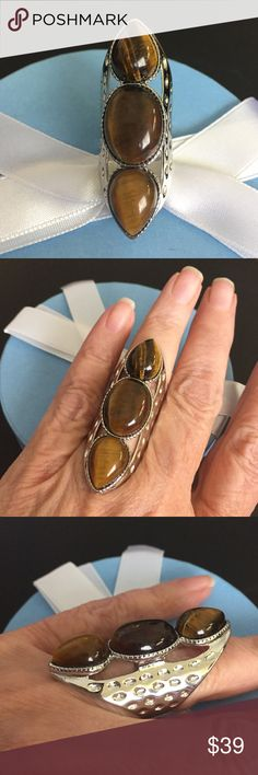 """Tigers Eye Ring sz 7 This is a beautiful ring, three Tigers Eye stones all set in bold stainless steel.  This measures a full 2"""" from end to end. Sz 7 R171 Jewelry Rings"""