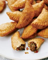 Mini Panamanian Beef Empanadas | At Panamonte Inn & Spa, chef Charlie Collins teaches students how to make perfectly flaky empanada dough. For fillings, he uses local ingredients like beef jerk (dried, preseasoned meat) and culantro (a long-leafed herb with a pungent flavor); ground beef and cilantro are fine substitutes.