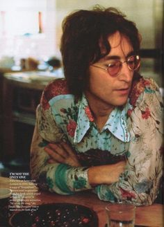 John Lennon. I have a pair of glasses like that :3