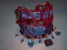 """Red Hot and Righteous Blues"" upcycled sari silk cuff bracelet - Raku, Labradorite and Garnet"