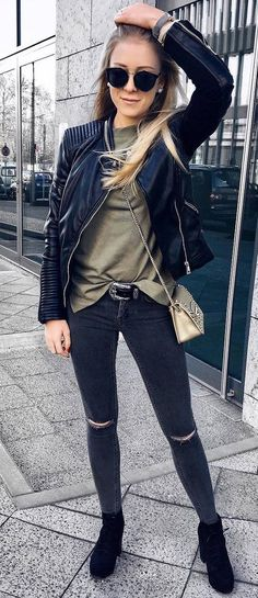 what to wear with a leather jacket : top + ripped jeans + boots