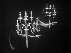 She acquired some of these helpful candelabra // Cocteau: La Belle Et La Bête (Beauty And The Beast)(1946)