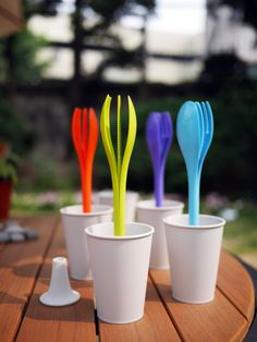 a plastic spoon,a plastic knife, a plastic fork, a plastic stand and a plastic cup  http://www.the-reflect.com/