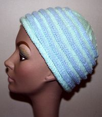 Ridged chemo hat - like the idea of this in two colors or school or team colors, would work for guys. Or a shockingly bright duo; lime green and bright aqua. -- size 5 dbl. pts.