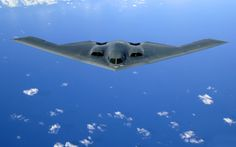 The Northrop B-2 Spirit, also known as the Stealth Bomber, is an American heavy penetration strategic bomber, featuring low observable stealth technology designed for penetrating dense anti-aircraft defenses; it is a flying wing design with a crew of two.[1][4] The bomber can deploy both conventional and thermonuclear weapons, such as eighty 500lb -class JDAM Global Positioning System-guided bombs, or sixteen 2,400lb B83 nuclear bombs. The B-2 is the only acknowledged aircraft that can…