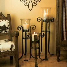 Discover decorating with wrought iron flair! Iron Accents is your source for unique wrought iron furniture, metal wall art, iron table bases, shelf brackets and more. Floor Candle Holders, Wrought Iron Candle Holders, Candle Stands, Large Candle Holders, Wrought Iron Decor, Iron Furniture, Tuscan Decorating, Home Decor Accessories, Country Decor