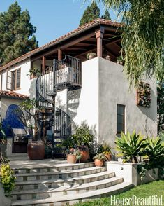 To enhance the hacienda-inspired architecture and connect the upper terrace with the patio, Dalton designed a wrought-iron staircase.