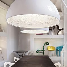 The Skygarden pendant light by Flos is a sleek lamp on the outside and a plaster masterpiece on the inside.