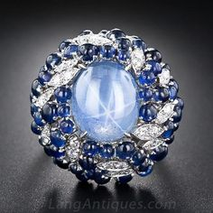 Vintage Star Sapphire Cocktail Ring,An enchanting 8 carat sky-blue star sapphire, displaying a billowy six-legged star, glows from the center of a big bombe-shape bauble crafted in 18 karat white gold - circa Vintage Star, Antique Jewelry, Vintage Jewelry, Bijoux Art Deco, Blue Star Sapphire, Ruby Sapphire, Sapphire Gemstone, Sapphire Jewelry, Sapphire Rings