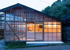 Roovice has converted a former warehouse in Miura into a bagel shop, replacing the existing walls with transparent polycarbonate panels