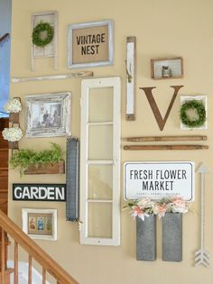 Farmhouse Style Gallery Wall for spring and summer. Great ideas to decorate a staircase gallery wall with vintage pieces.