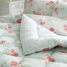 For a stylish way to snuggle up, try our lovely quilted Antique Rose eiderdown. The vintage inspired print features fresh pink florals on a duck egg background.  It is fully reversible with the option of our Spotty design too. Perfect for an extra layer on cold nights or simply use as a decorative quilt.
