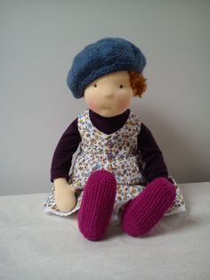 The doll in blue beret