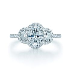 Kwiat's oval ring with half moons on both sides surrounded by diamonds and a pave band. Style No. 17711V