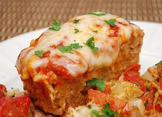 Chicken Parmesan Meatloaf: This recipe is wonderful. Incredibly easy to put together, full of flavor and I was even able to make it gluten free for myself by substituting 1/4 cup almond flour for the breadcrumbs. I also substituted lean (97/3) ground turkey for the ground chicken because it's what I had on hand. I'm actually looking forward to the leftovers tomorrow! =)