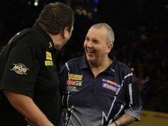 Phil Taylor came out on top against world champion Adrian Lewis
