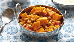Sweet potato and chickpea curry.  Will probably add some green peas at the end for colour and texture.