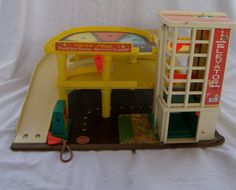 Vintage Fisher Price Parking Garage  Omg I played with this for hours. Had the airplane too!