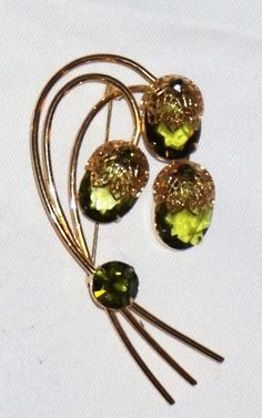 """For your consideration is """"Touch of Elegance"""" brooch pin, from Saraha Coventry. This design was recently confirmed as being produced by Delizza and Elster, the makers of the famous Juliana line. The metal is gold tone. with three ample olivine,. Christmas Shopping Online, Cheap Jewelry, Coventry, Brooch Pin, Costume Jewelry, Bobby Pins, Vintage Jewelry, Hair Accessories, Touch"""