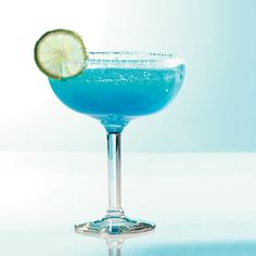 "Blue Lagoon Margaritas Recipe -This is one super drink that'll have the neighbors asking, ""What's that?"" Show them and make an extra batch to share. —Willie DeWaard, Coralville, Iowa"