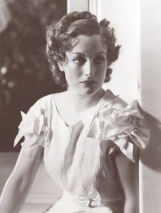 1930s Joan Crawford wearing a bow dress
