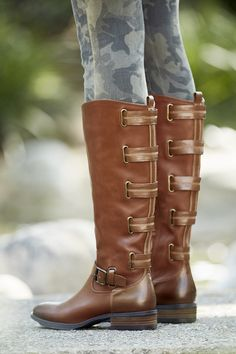 Flat tall boot that's part riding boot, part moto boot. The vintage cognac leather makes this shoe a staple in every wardrobe.   Sole Society Franzie