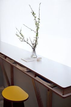 dining-rooms-white-yellow-books-counter-stools-countertops-plants-restaurants-vases