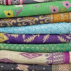 More vintage Kantha quilts.  Hand-stitched quilts made from vintage saris.