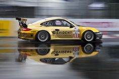 The GTC JDX Racing Porsche 911 GT3 Cup - What an awesome picture, love the reflection and the gold wrap.
