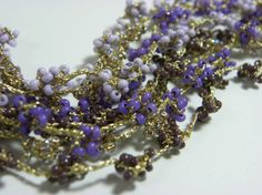Hand Bracelet, Crochet Knitting, 8 lines of Glass beads, Purple,  Hand Made, Polyester and cotton strings Gold Plated rings and Clasps.