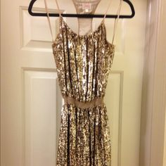 Parker Dress Parker Gold Sequin racerback dress in a size medium. In great condition since it was only worn for a few hours! Parker Dresses Mini